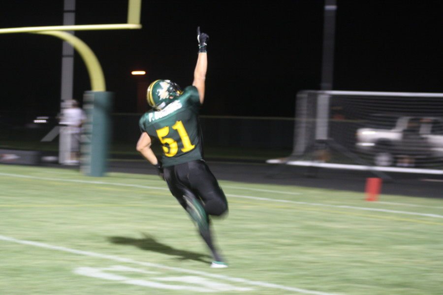 At the Loyalty Day football game, senior Paul Boidanis points to the sky after he scores a touchdown. He said he does this because he plays for the boys who died this past summer. Photo by Jessica Hoffen.