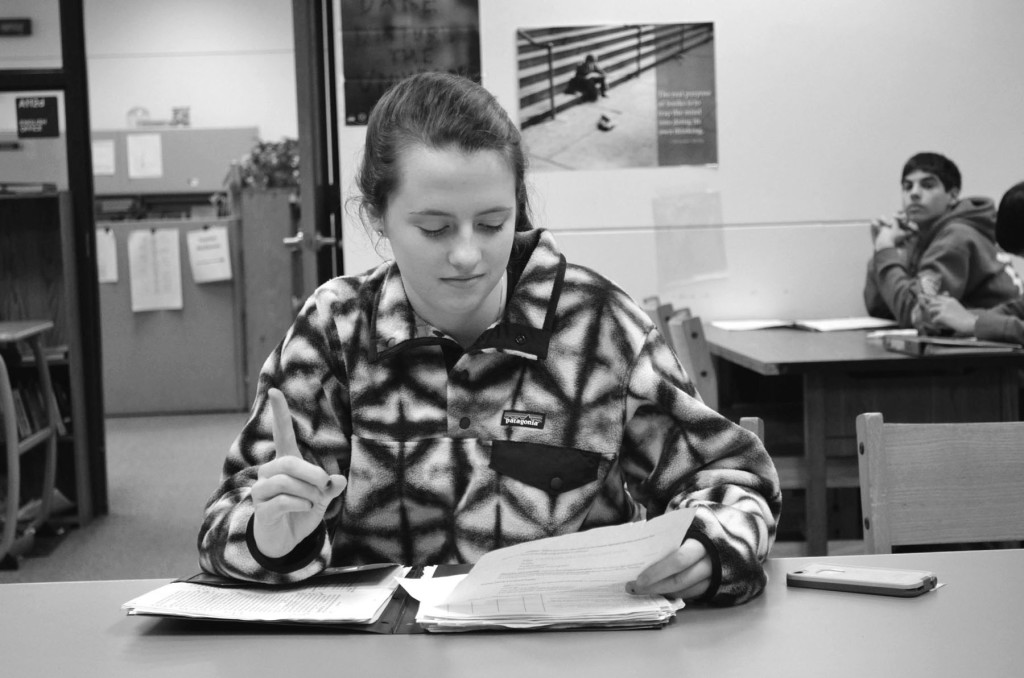 Sophomore Carly Smith uses sign language as a study strategy. She has studied for Spanish tests by using the sign language alphabet to help her memorize the spelling of vocabulary words. Photo by Gabe Weininger
