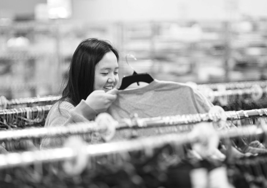 Junior Ruth Um thrifts at Goodwill, looking for men's oversized sweatshirts. Um has gone thrift shopping at stores such as Goodwill in the past to find pieces she can upcycle and make into something new and original.