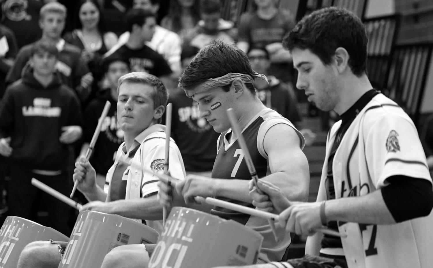Seniors Daniel Spencer, Sam Heydt and Ben Harkey (left to right) play at their last performance together during the 2018 Pride Assembly. The group has been performing together since eighth grade, and they have played in Glenbrook North assemblies and Variety Shows. Photo by Richard Chu
