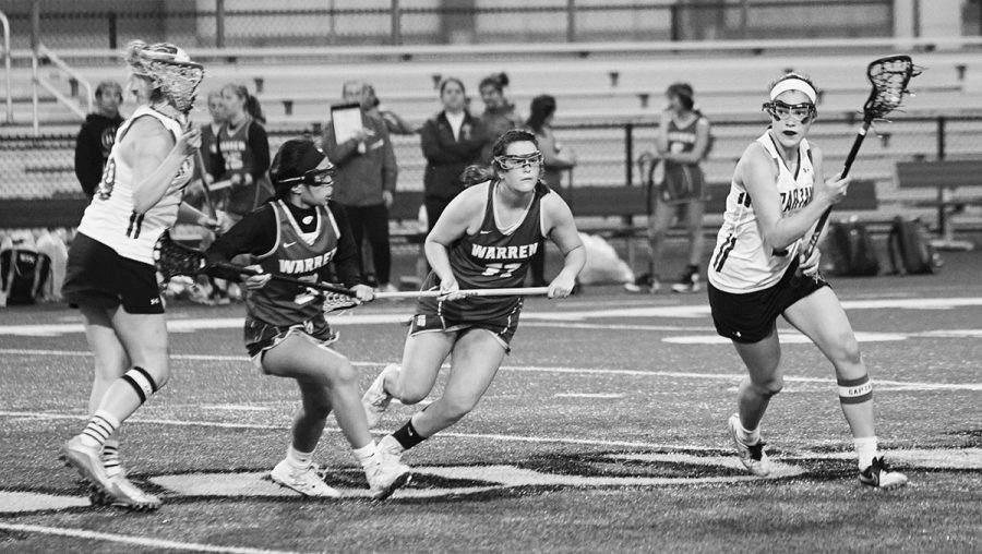 Senior+Naomi+Lutz+%28right%29+plays+offense+in+the+girls+lacrosse+game+against+Warren+Township+on+May+14.+Next+year%2C+she+plans+to+attend+the+Massachusetts+Institute+of+Technology+as+a+lacrosse+commit.+Photo+by+Richard+Chu.