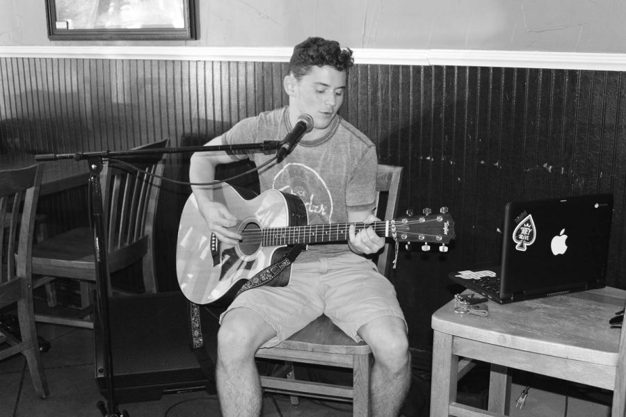 Junior Quinn Cassell plays guitar and sings at Potbelly Sandwich Shop in Highland Park. Cassell began learning how to play the guitar at age 9.