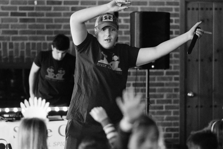Freshman Ryan Kreiter leads the audience in a dance at a pajama birthday party on Jan. 26 while freshman Adam Shaw controls the music. The duo formed their own entertainment company called Spice City Music in 2015.