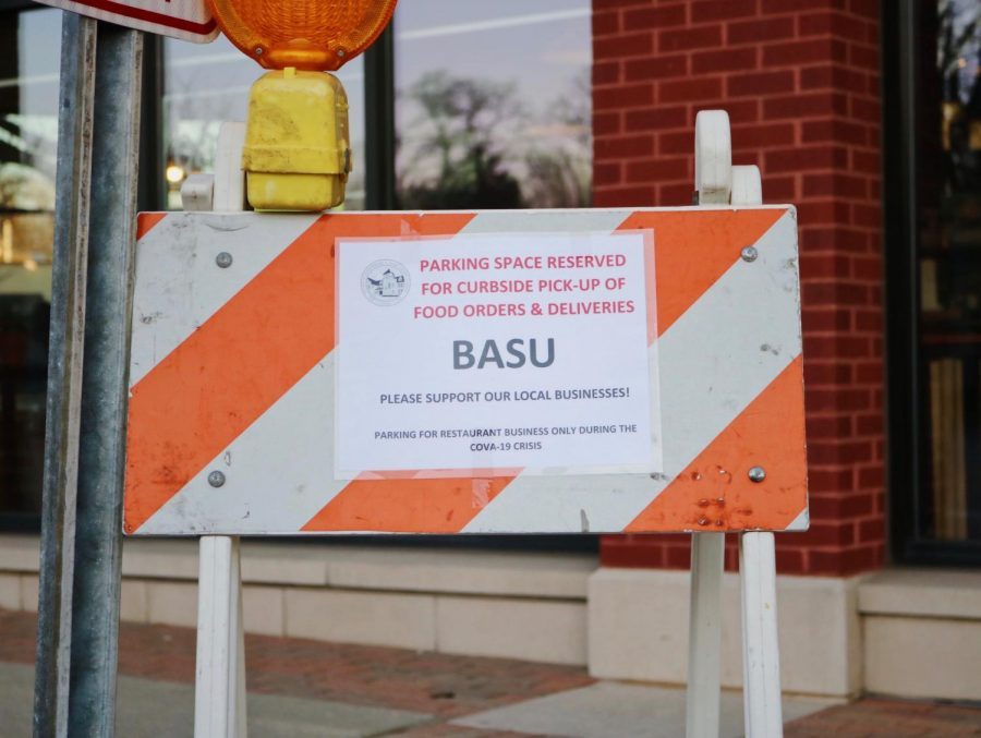A sign outside Basu, coffee bar and Vietnamese eatery, tells customers that parking is reserved for curbside pick-up only. Since Gov. J.B. Pritzker issued a mandate forbidding restaurants from serving dine-in customers, Basu has been struggling to obtain revenue. Photo by Sarah Boeke