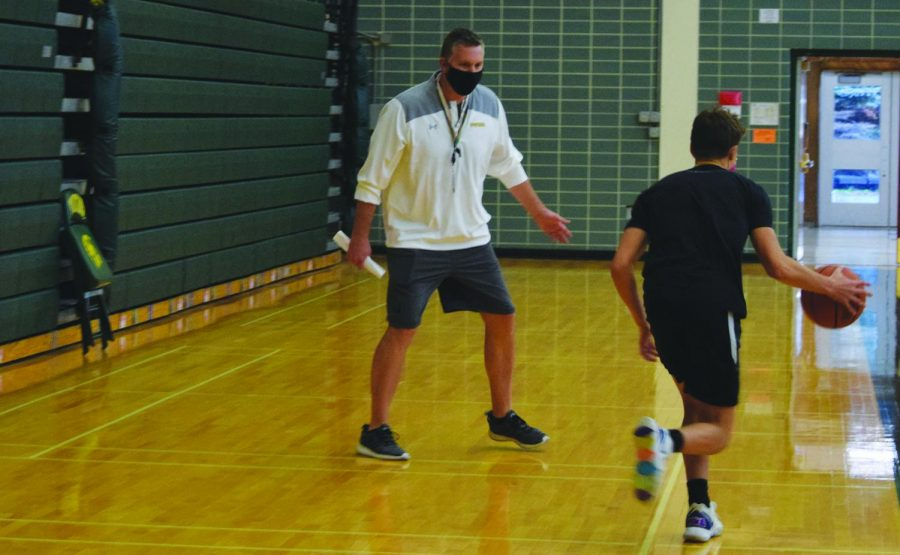 Quin Hayes, head boys varsity basketball coach (left), works with players at a contact day on Nov. 4. Hayes was hired in April after six seasons at Saint Viator High School. Photo by Natalie Sandlow
