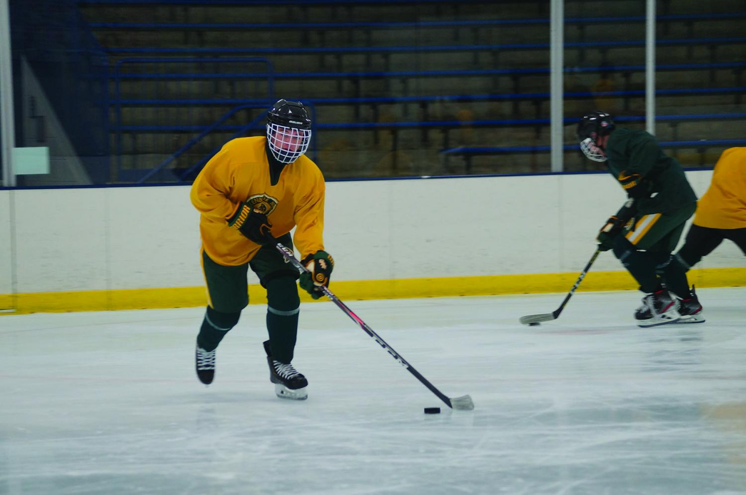 Sophomore Owen Just works on his puck handling at a practice on Oct. 29. Just started his hockey career in the GBN youth system with the Northbrook Bluehawks, but then switched to play club hockey for Chicago Young Americans when he was seven years old. Just now plays for the GBN varsity team. Photo by Dylan Buckner