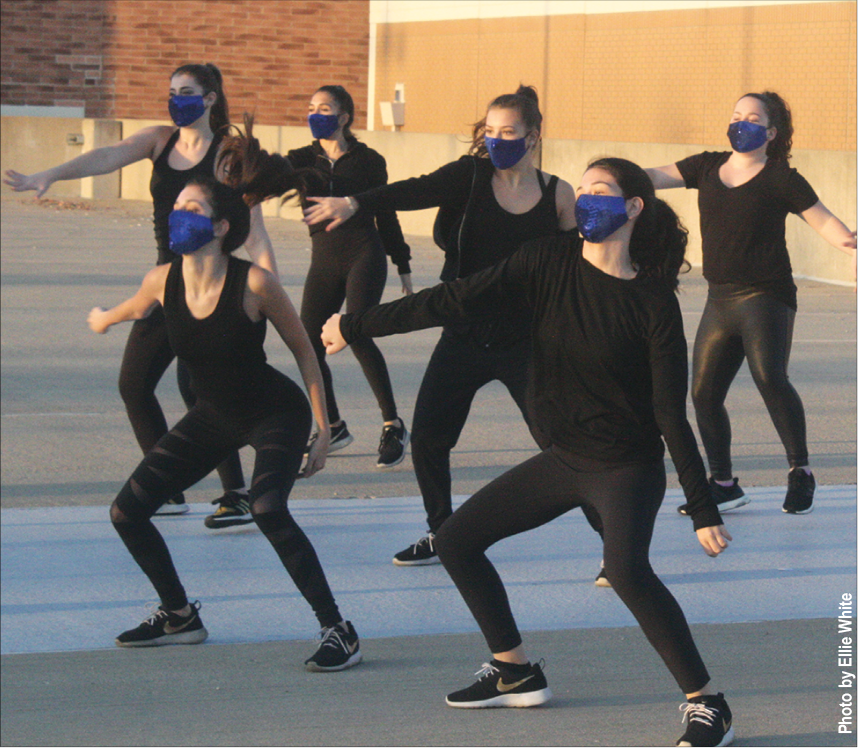 Members of Orchesis rehearse outdoors for the virtual Orchesis show. Some experts have predicted that cold weather will result in more people gathering indoors, which would make it easier for COVID-19 to spread. Photo by Ellie White