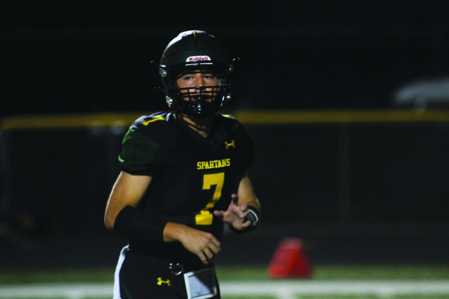 Dylan Buckner plays during the 2019 Homecoming football game against Glenbrook South. Buckner was the starting varsity quarterback during his sophomore and junior seasons. Photo courtesy of Stuart Rodgers