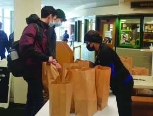 Students pick up free meals near the Student Activities Center. Since March 2020, Glenbrook High School District #225 has participated in a federally funded free meal program. Photo by Jenna Amusin
