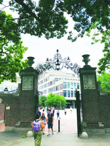 Prior to the COVID-19 pandemic, visitors and students walk around Harvard University