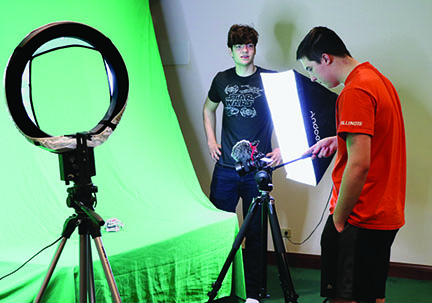 "For their upcoming film, ""Outerlands,"" seniors Alexander Kardasis (left) and Wyatt Wolf film their robot named ""K.I.T."" They began filming ""Outerlands"" after finishing their short film ""Incompatible,"" which won first place in the IHSA Drama State Series Film Festival. Photo by Alex Garibashvily"