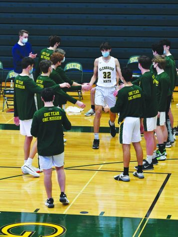 Freshman Patrick Schaller is announced as a starter before his game against Maine West on Feb. 27. Schaller started in all but one game this season. Photo by Natalie Sandlow
