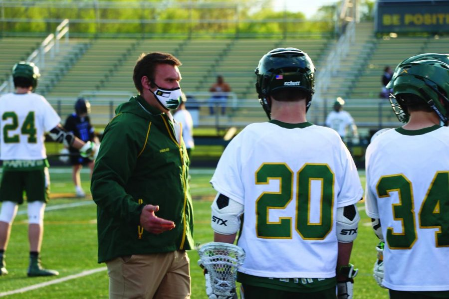 Before the opening face-off against Highland Park on May 6, Justin Georgacakis, head boys lacrosse coach,  talks with his players. Georgacakis has implemented various team bonding exercises such as paintball. Photo by Alex Garibashvily