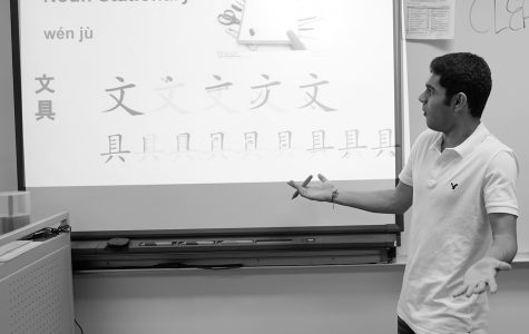 Executive News Editor Sahil Modi gets lost in the subtleties of the Chinese language during a staged vocabulary presentation. Although his pronunciation has improved since freshman year, he values the friends made more than the words learned. Photo by Richard Chu