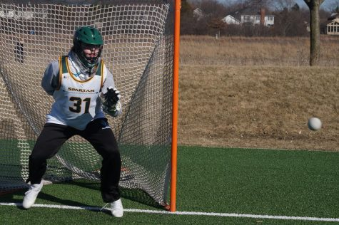 Goalie Cade Bauer practices saves without a stick at Techny Prairie Park and Fields. Bauer said the implementation of VR technology into the lacrosse program would help improve his training. Photo by Dylan Buckner