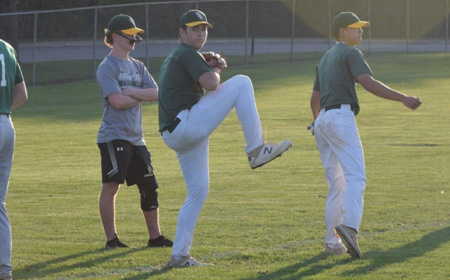 Winding up, senior Eric Orloff practices his pitching. Orloff and the varsity boys baseball team have been involved in off-season training throughout September. Photo by Natalie Sandlow