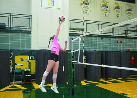 Junior Ava Spaniak practices her attacking skills at a volleyball open gym on Feb. 17. Spaniak was a member of the 2019-20 Spartan Athlete Leadership Team, consisting of 30 leaders across all GBN sports. Photo by Jenna Amusin