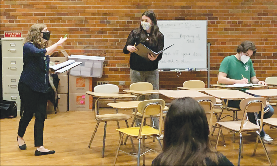 """During a rehearsal on March 17, sophomore Leah Popovskiy and choir teacher Kelsey Nichols work on blocking for the part of Alice Beineke. """"The Addams Family"""" was selected as this year's Glenbrook musical in part because it had a new quarantine edition with a script adapted to COVID-19 regulations. Photo by Alyssa Sanchez"""
