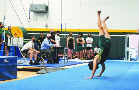 At a varsity boys gymnastics meet against Glenbrook South on April 6, sophomore Sam Diaz performs his floor routine. While this meet was held in person, girls gymnastics and bowling teams participated in virtual meets throughout their seasons, which required them to compete at locations separate from their opponents. Photo by Saruul-Erdene Jagdagdorj