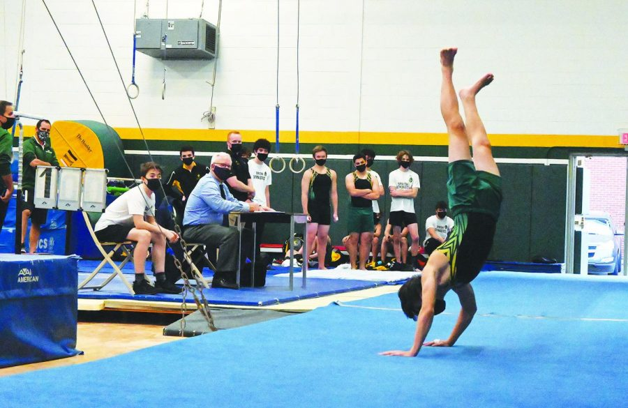 At+a+varsity+boys+gymnastics+meet+against+Glenbrook+South+on+April+6%2C+sophomore+Sam+Diaz+performs+his+floor+routine.+While+this+meet+was+held+in+person%2C+girls+gymnastics+and+bowling+teams+participated+in+virtual+meets+throughout+their+seasons%2C+which+required+them+to+compete+at+locations+separate+from+their+opponents.+Photo+by+Saruul-Erdene+Jagdagdorj