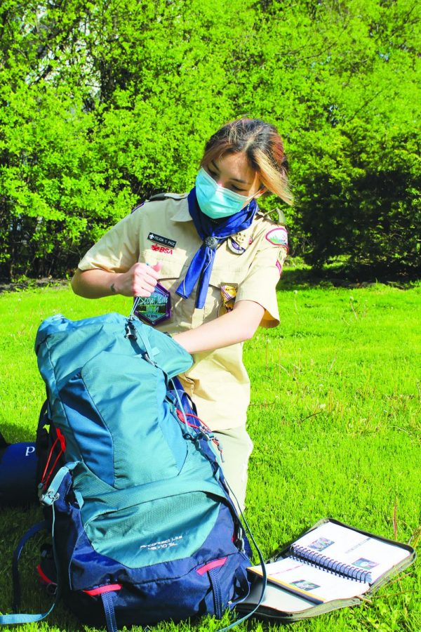 Sophomore Felicia Pace unpacks her backpack after a camping trip with Troop 64G. Pace started the troop with her father after Scouts BSA started welcoming girls and boys to join. Photo by Audrey Gottschild