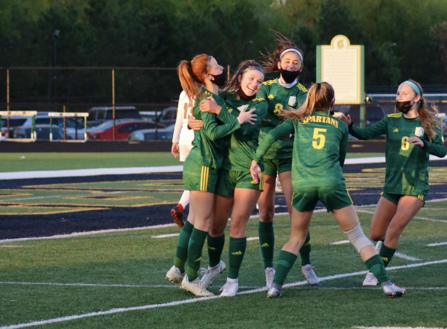 After scoring a goal against Evanston to tie the game 1-1, junior Margy Porta (far left) celebrates with her teammates on May 7. The final score was 2-2, and as of May 21, the team has a record of 9-1-3. Photo by Sarah Boeke