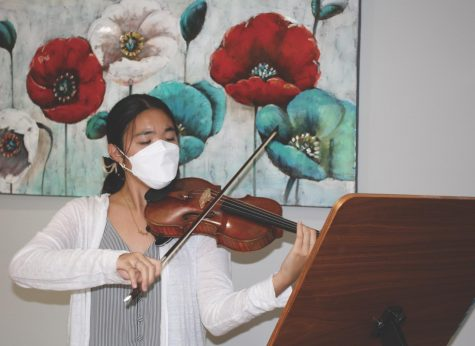 After school, senior Abby Park practices Tchaikovsky Violin Concerto in D major, Op 35. Park has played violin since she was four years old and began playing at the Music Institute of Chicago Academy in eighth grade. Photo by Claire Satkiewicz